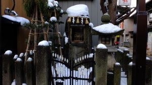 Snow covered road side shrine
