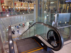 The escalator's ends is designed in the style of an rotating old train wheel